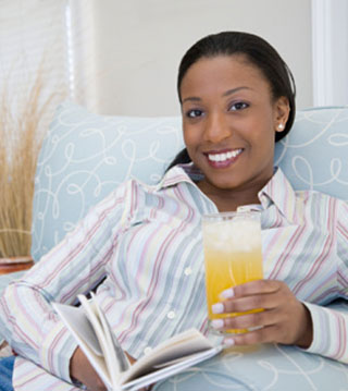 Smiling woman with orange juice