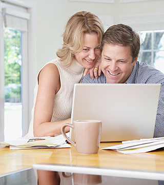 Young Couple looking at laptop screen
